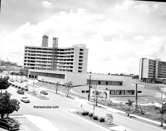 The Plaza Civica, while it was under construction. The top of the Jose Marti Monument is visible behind the building. Later, Castro changed its name to Plaza de la Revolucion
